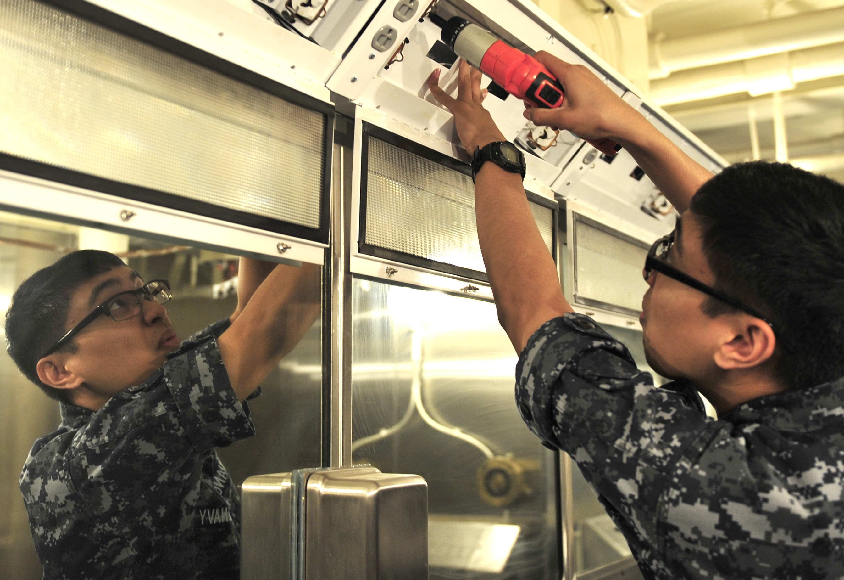 Pre-commissioning Unit Gerald R. Ford (CVN 78) Sailors renovate showcase berthing 150423-N-AO748-062.jpg English: Electrician's Mate Fireman