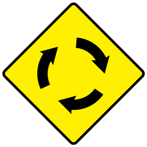W043 - Roundabout Ahead - Warning Sign Ireland.png