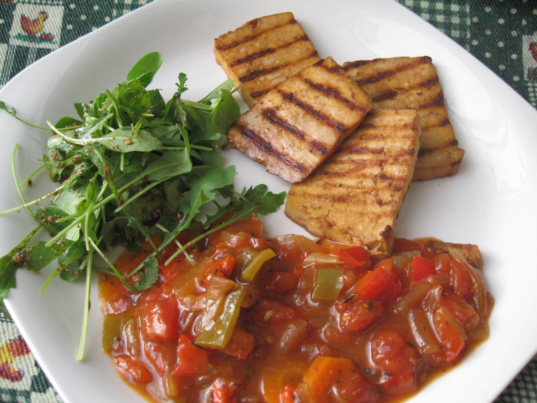 A plate of soy-protein rich grilled tofu, vegetables, and a salad