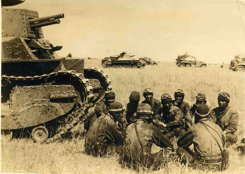 Tank crews gathered in front of a Type 89 Chi-Ro tank