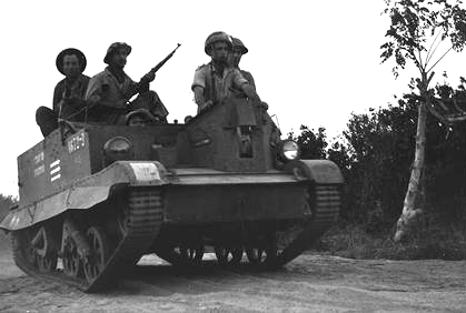 IDF soldiers of the Samson's Foxes unit advance in a captured Egyptian Bren Gun carrier. BrenCarrierShualeiShimshon.png