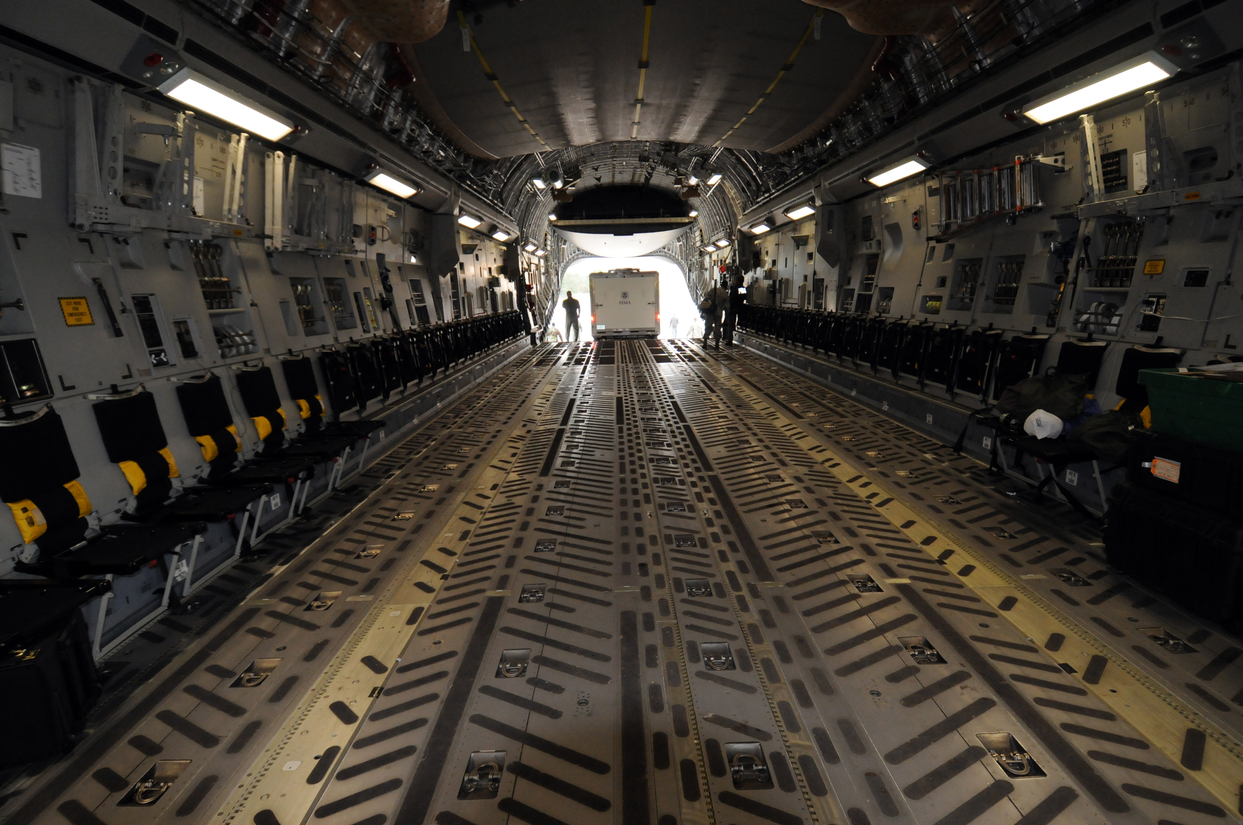 File:FEMA - 42026 - Truck being loaded into a C-17 plane ...