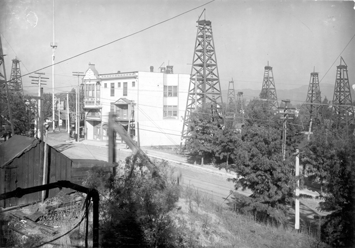Los Angeles City Oil Field, Los Angeles, California, from First Street and Belmont Avenue, facing east