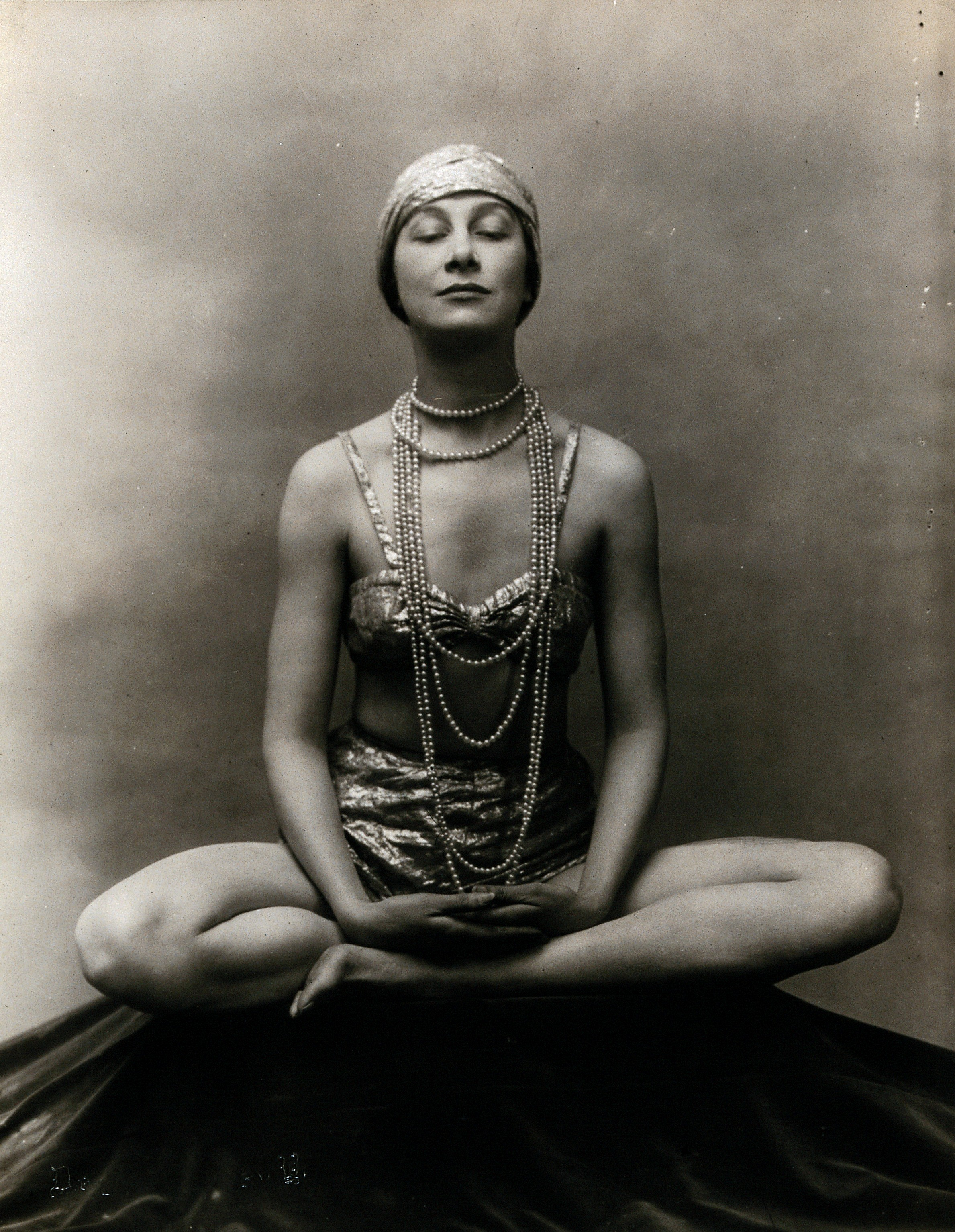 Marguerite Agniel in a Buddha position with her legs crossed Wellcome V0048585.jpg