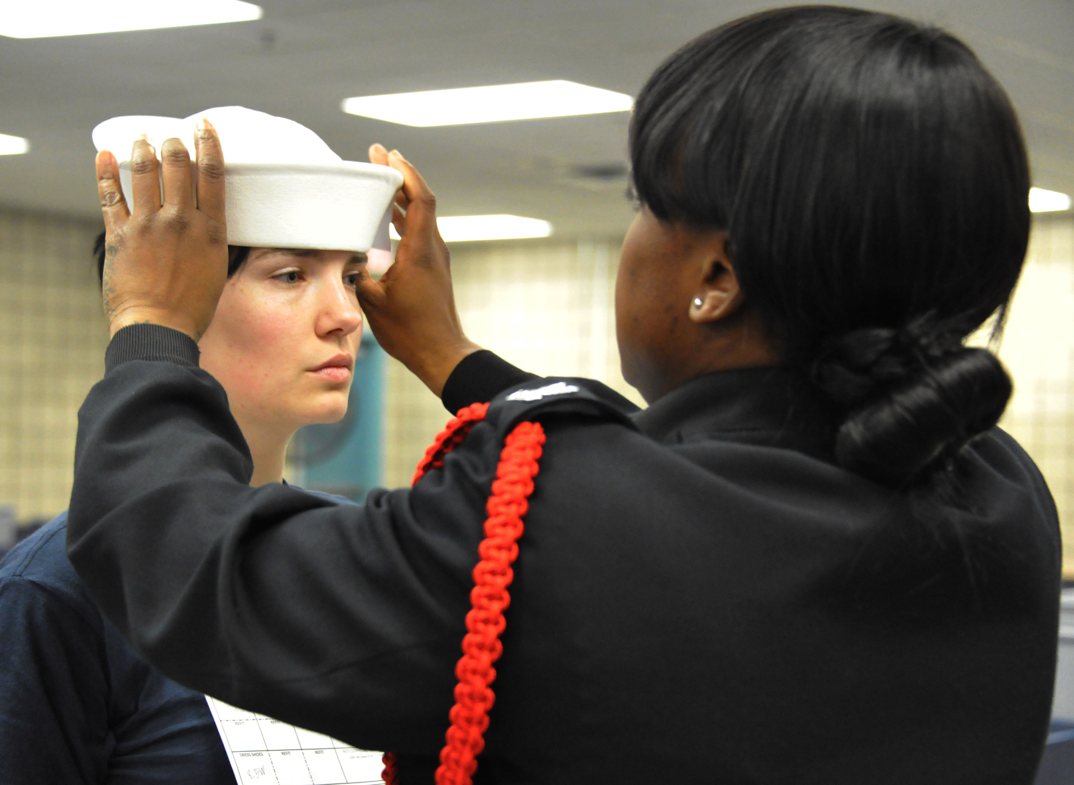 File Sailor ensures the proper fit of Seaman s white enlisted hat ... 28c83c6be0d