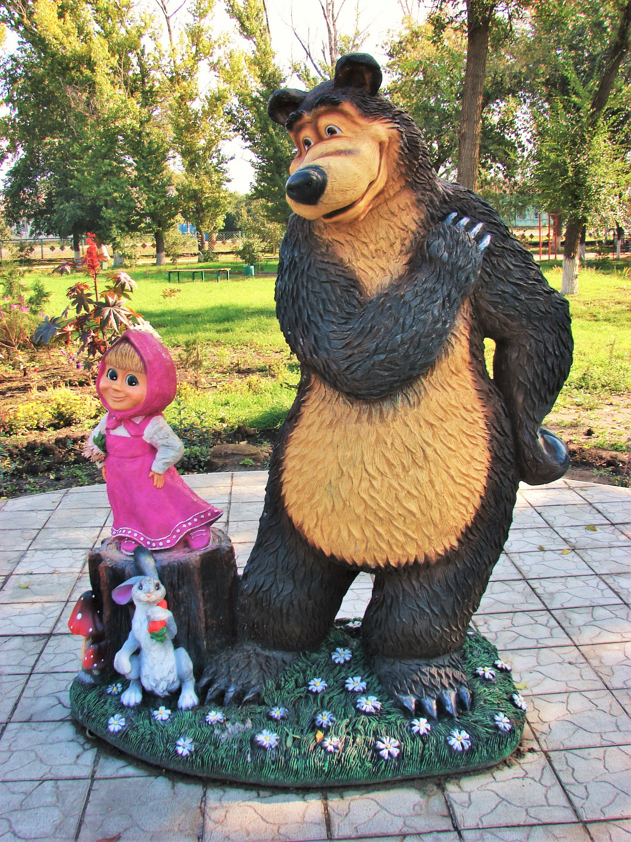 A Sculpture Of Masha And The Bear Along With Their Friend Hare In Yelan
