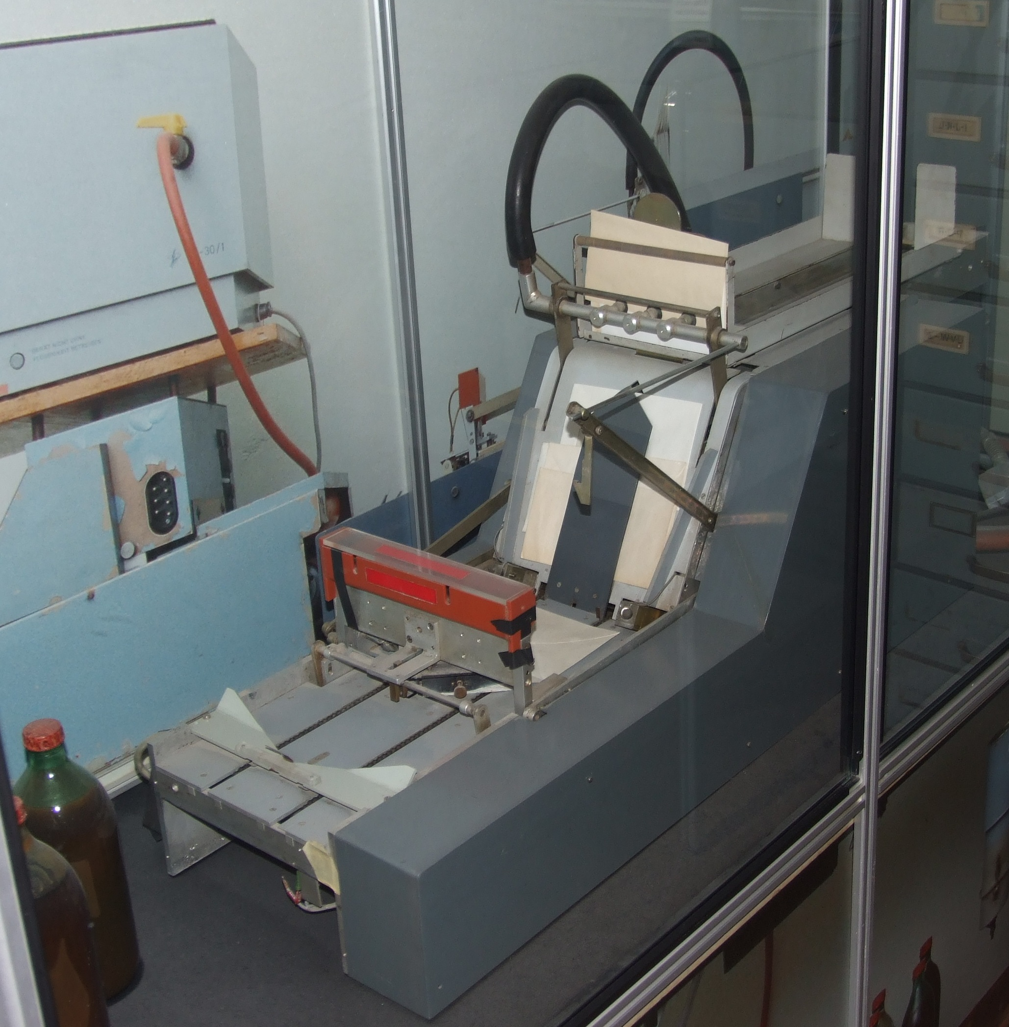 A Stasi automated machine to re-glue envelopes after mail had been opened for examination