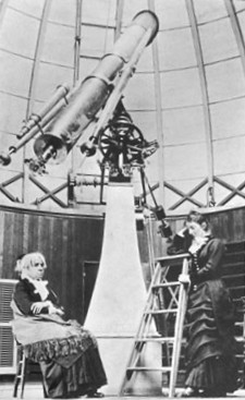 Maria Mitchell (seated) inside the dome of the Vassar College Observatory, with her student Mary Watson Whitney (standing), circa 1877 Mitchell Maria telescope.jpg
