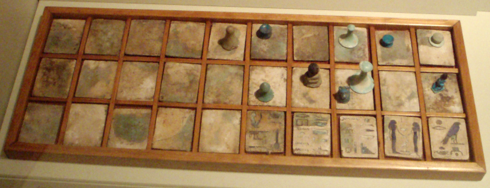 Senet board with religious markings in the ROM, photo by Keith Schengili-Roberts