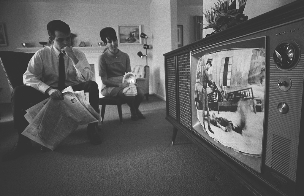 An American Man And Woman Watching Footage Of The Vietnam War On Television In Their Living Room February 1968