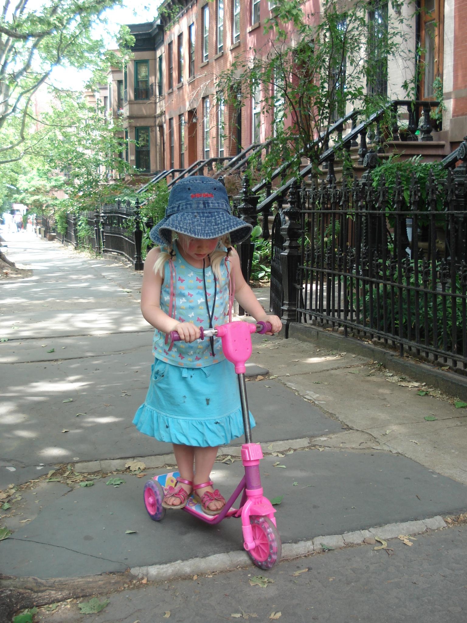 file little girl on scooter 4699130259 5751c2995e