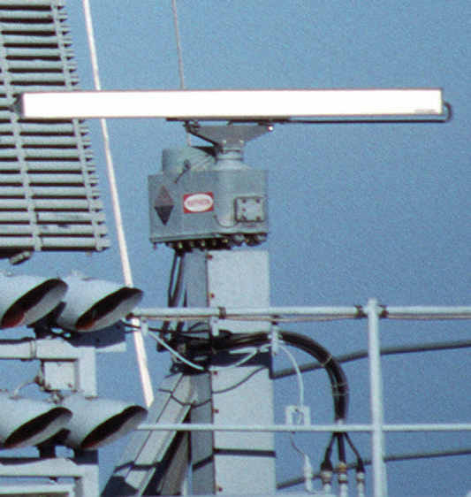 X-band (8 - 12 GHz) marine radar antenna on a ship. The rotating bar sweeps a vertical fan-shaped beam of microwaves around the water surface to the horizon, detecting nearby ships and other obstructions Radar antennas on USS Theodore Roosevelt SPS-64.jpg