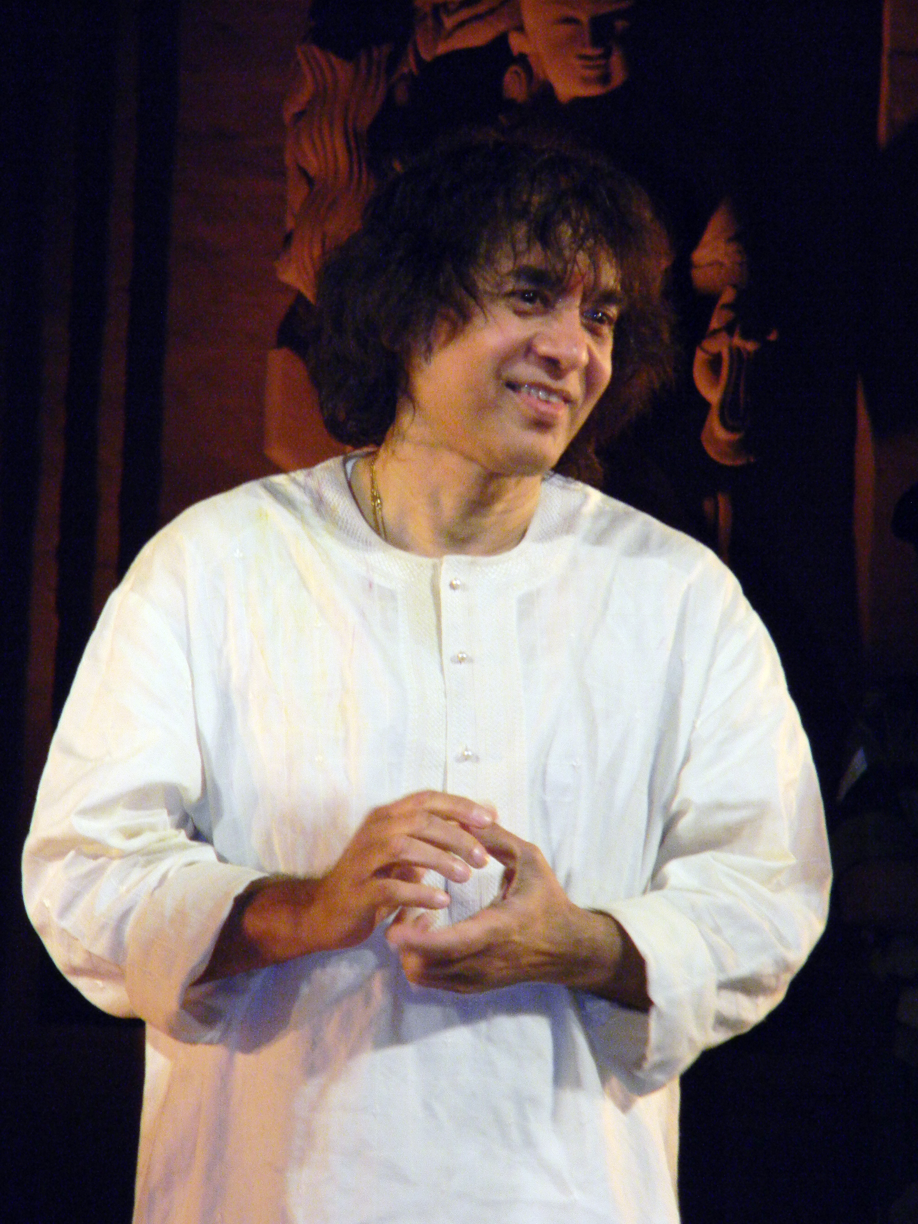 The 67-year old son of father (?) and mother(?), 176 cm tall Zakir Hussain in 2018 photo