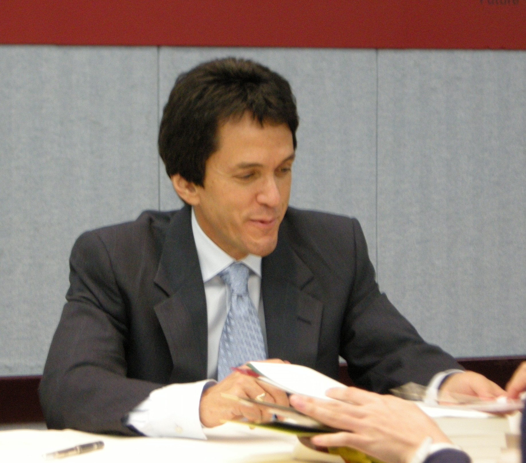 Albom autographing for his fans after a lecture of his in 2010