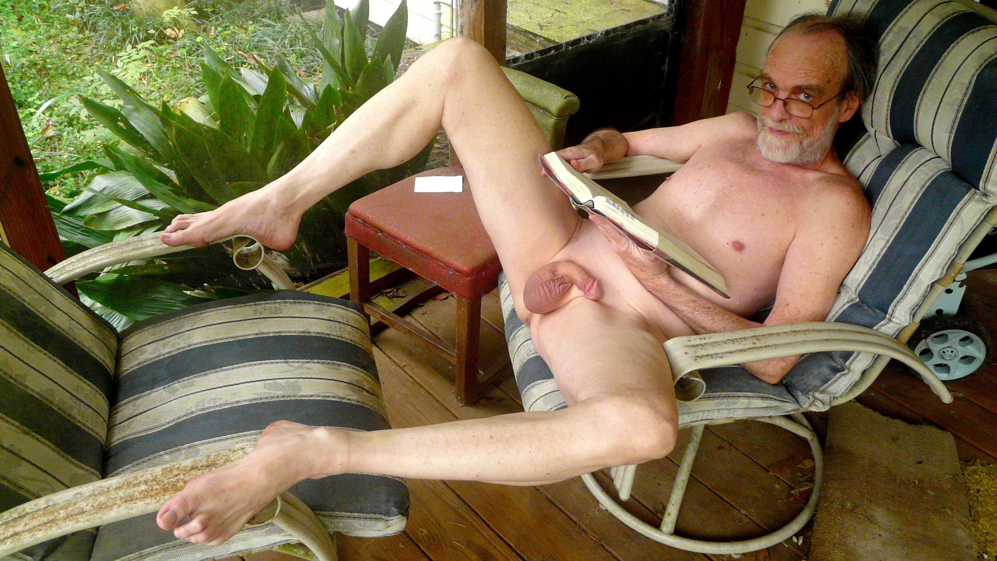 nude man sitting legs open
