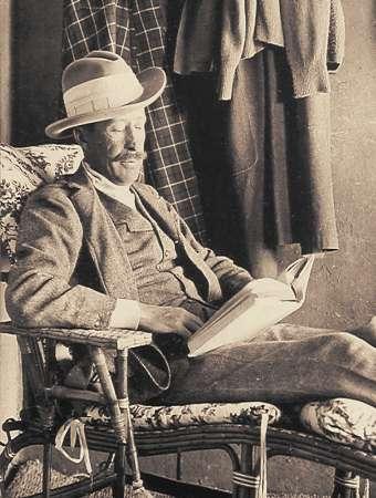 George Herbert, 5th Earl of Carnarvon, reading