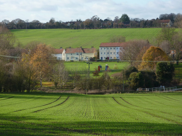 Green fields sloping down to Clay Lane - geograph.org.uk - 1598216