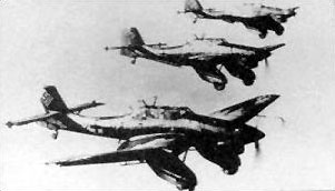"Formation of Ju 87A dive-bombers, with the A's characteristic large wheel ""trousers"", each having one transverse bracing strut Ju87A 050406-F-1234P-041.jpg"