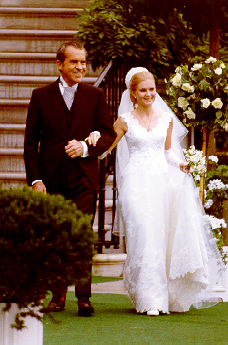 """Richard Nixon looks stunning in that white dress, but who's the guy standing on his right? ALTERNATE JOKE: """"Some TV show wants the rights to my middle name - sounds fine, I'm not using it."""""""