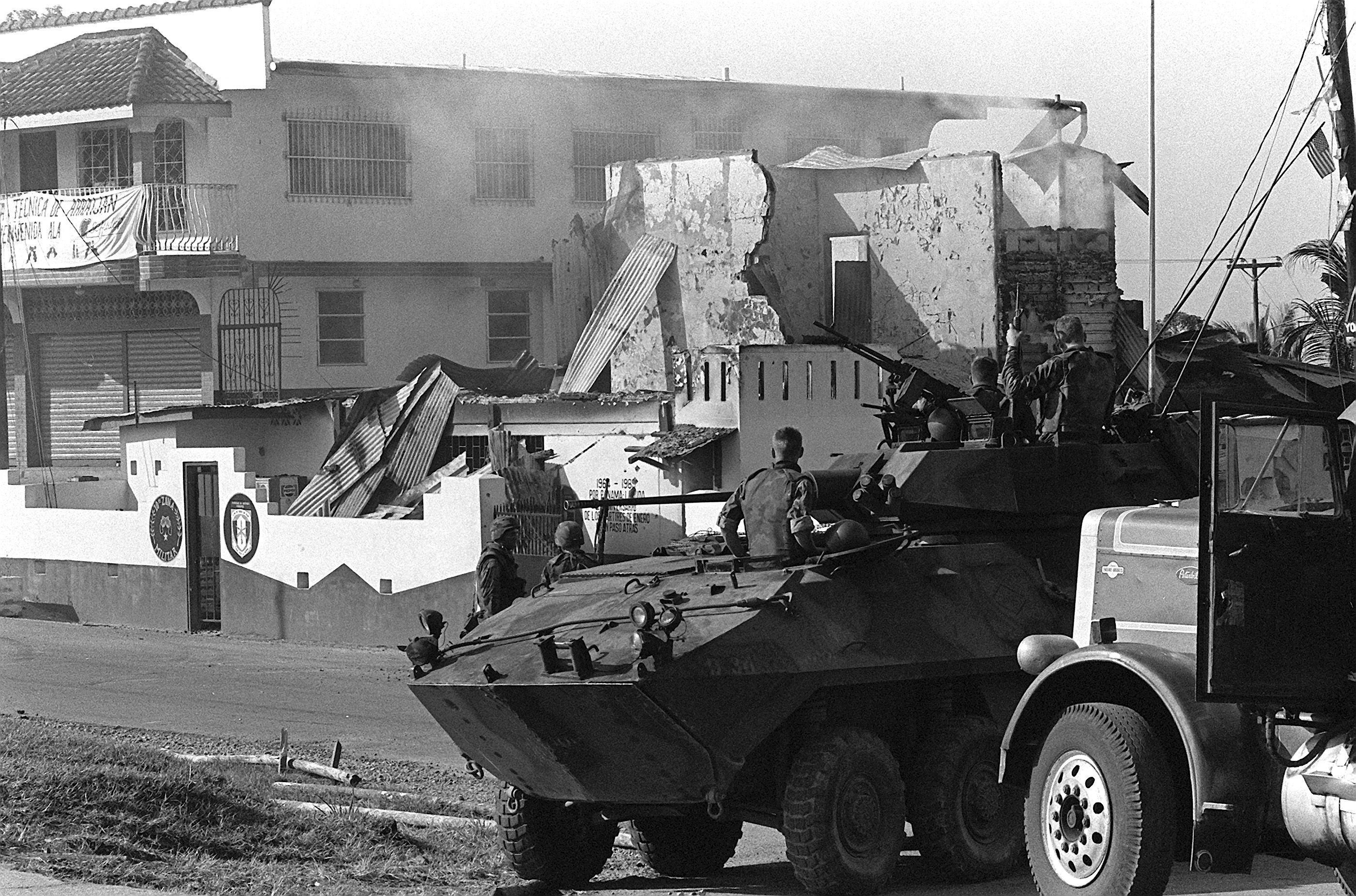 Invasion of Panama – Marines of Company D, 2nd Light Armored Infantry Battalion, stand guard with their LAV-25s during the first day of Operation Just Cause