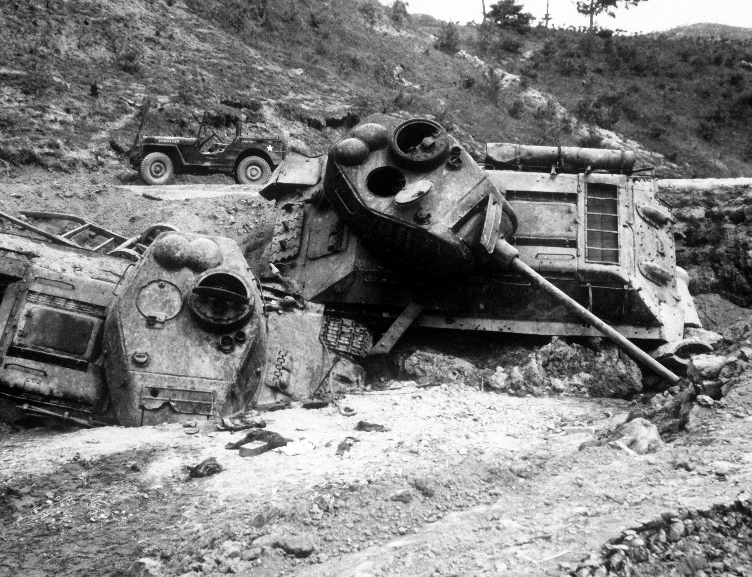 A pair of heavily damaged tanks destroyed in a ditch
