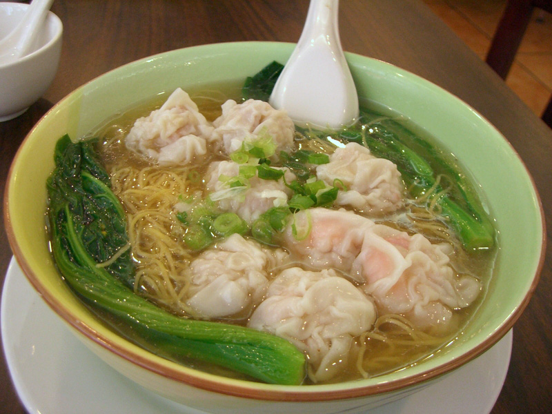 ... bowl of wonton soup with bochoy, noodles, green onions, and wontons
