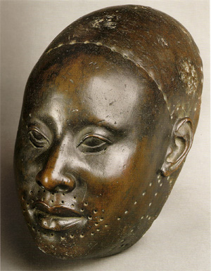 Yoruba copper mask of Obalufon from the city of Ife, c. 1300 Yoruba-bronze-head.jpg