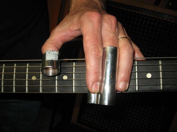 a crash course on sliding a legato technique master guitarists love merriam music toronto 39 s. Black Bedroom Furniture Sets. Home Design Ideas