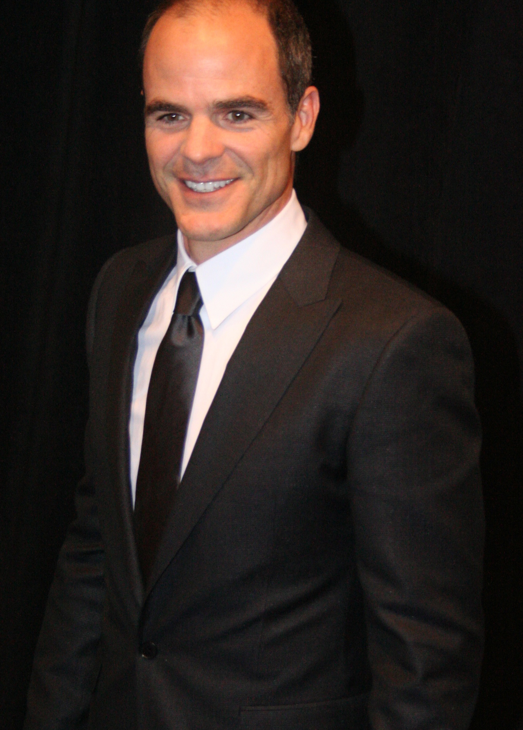The 49-year old son of father (?) and mother(?) Michael Kelly in 2018 photo. Michael Kelly earned a  million dollar salary - leaving the net worth at 3 million in 2018