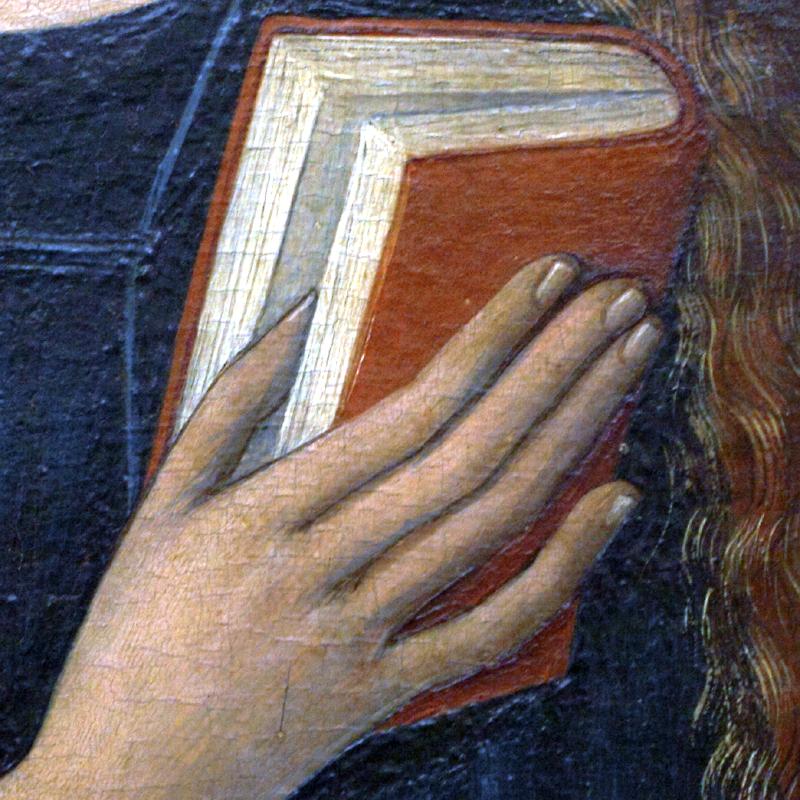mano con libro