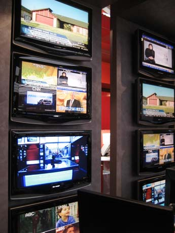 The monitors of the MSNBC newsroom are tuned into various global channels. 111907f.jpg