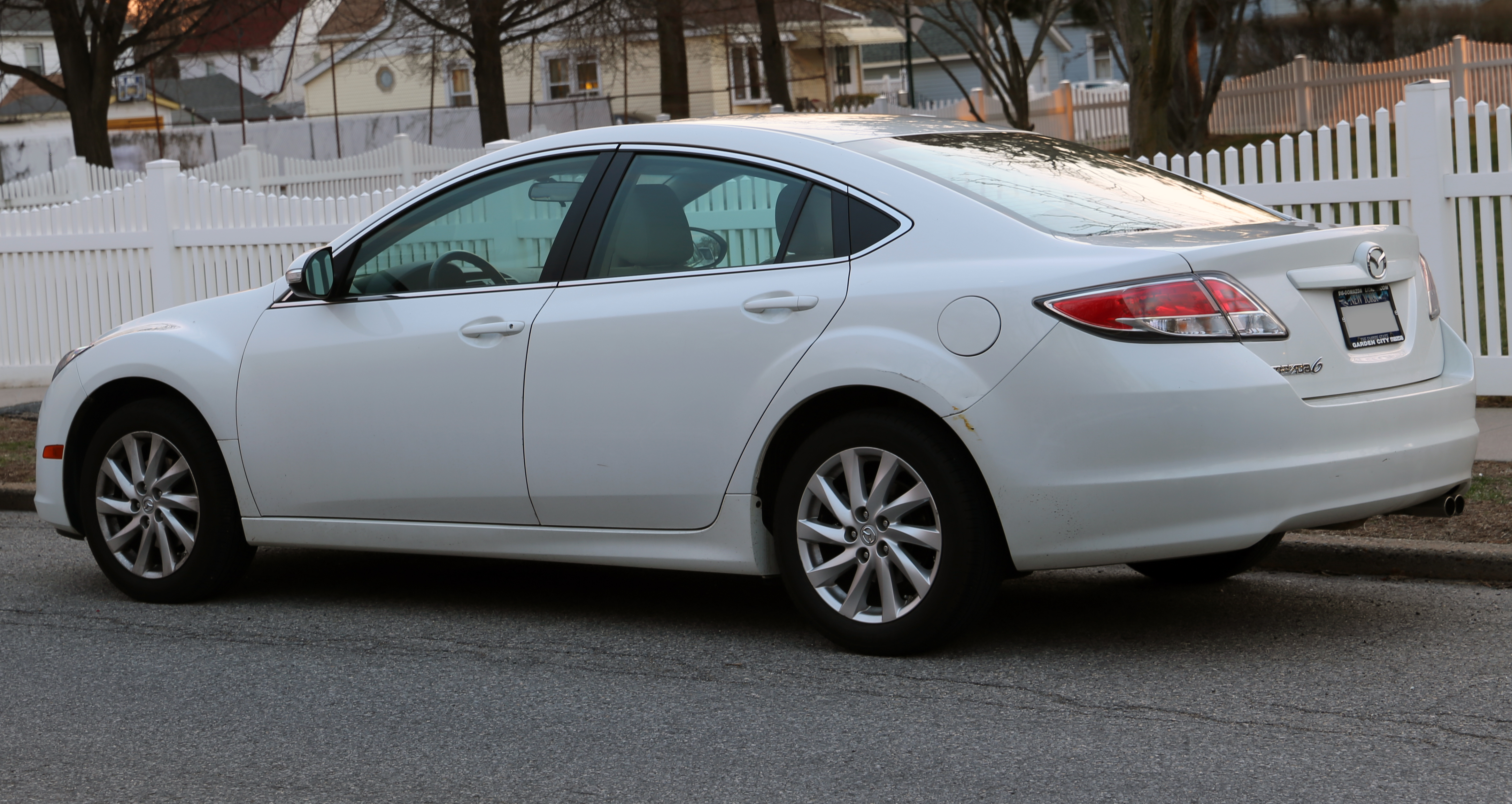 https://upload.wikimedia.org/wikipedia/commons/1/1f/2011_Mazda6i_Touring_Sedan_rear_left.jpg