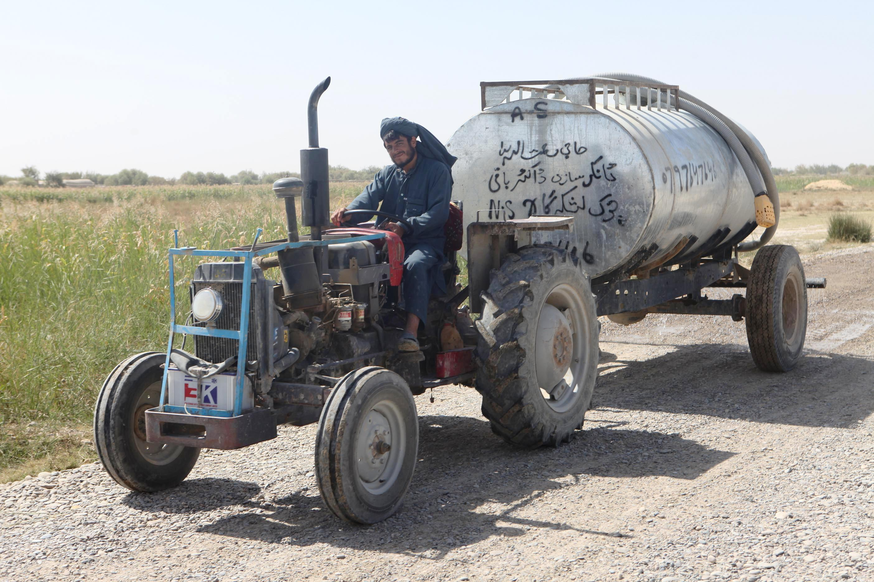 Guy On Tractor : File afghan man on his tractor g wikimedia commons