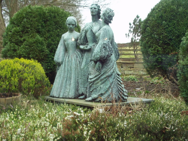 A bronze statue of the Brontë sisters at the Parsonage Museum in Haworth, England.