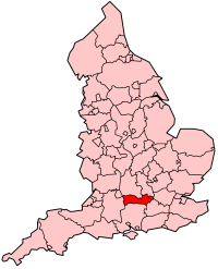 A map of a country, divided into many smaller counties. One county, situated in a southern-central location, is highlighed in red