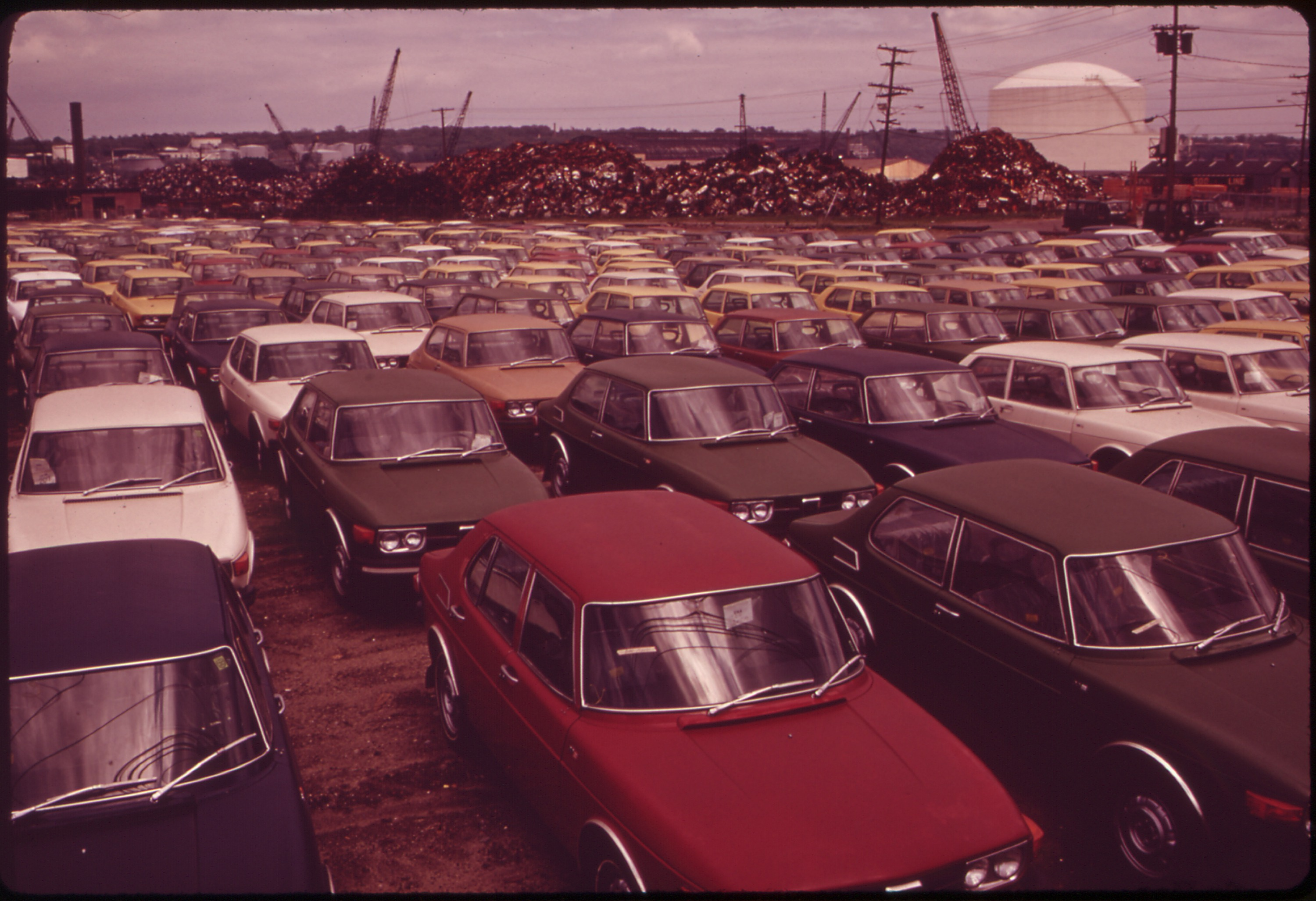 File:NEW CARS, AND SCRAP METAL FROM OLD CARS (IN BACKGROUND) READY ...