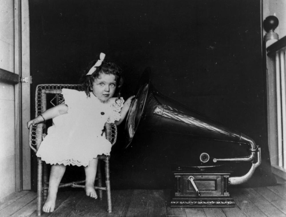 Picture of girl listening to old Victorola