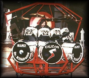 "Heavy metal drumsets are typically larger than those used in other rock genres. In the drum kit pictured, the drummer has three bass drums. Steve ""Doc"" Wacholz Drum Kit.jpg"