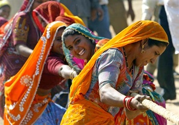 Women in tug of war game at Pushkar fair, Rajasthan, India