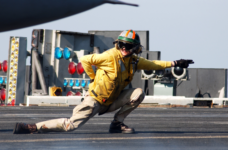 US_Navy_051213-N-9362D-009_Lt._Cmdr._Molly_Boron_gives_the_signal_to_launch_an_F-14D_Tomcat_on_the_flight_deck_aboard_the_Nimitz-class_aircraft_carrier_USS_Theodore_Roosevelt_(CVN_71).jpg