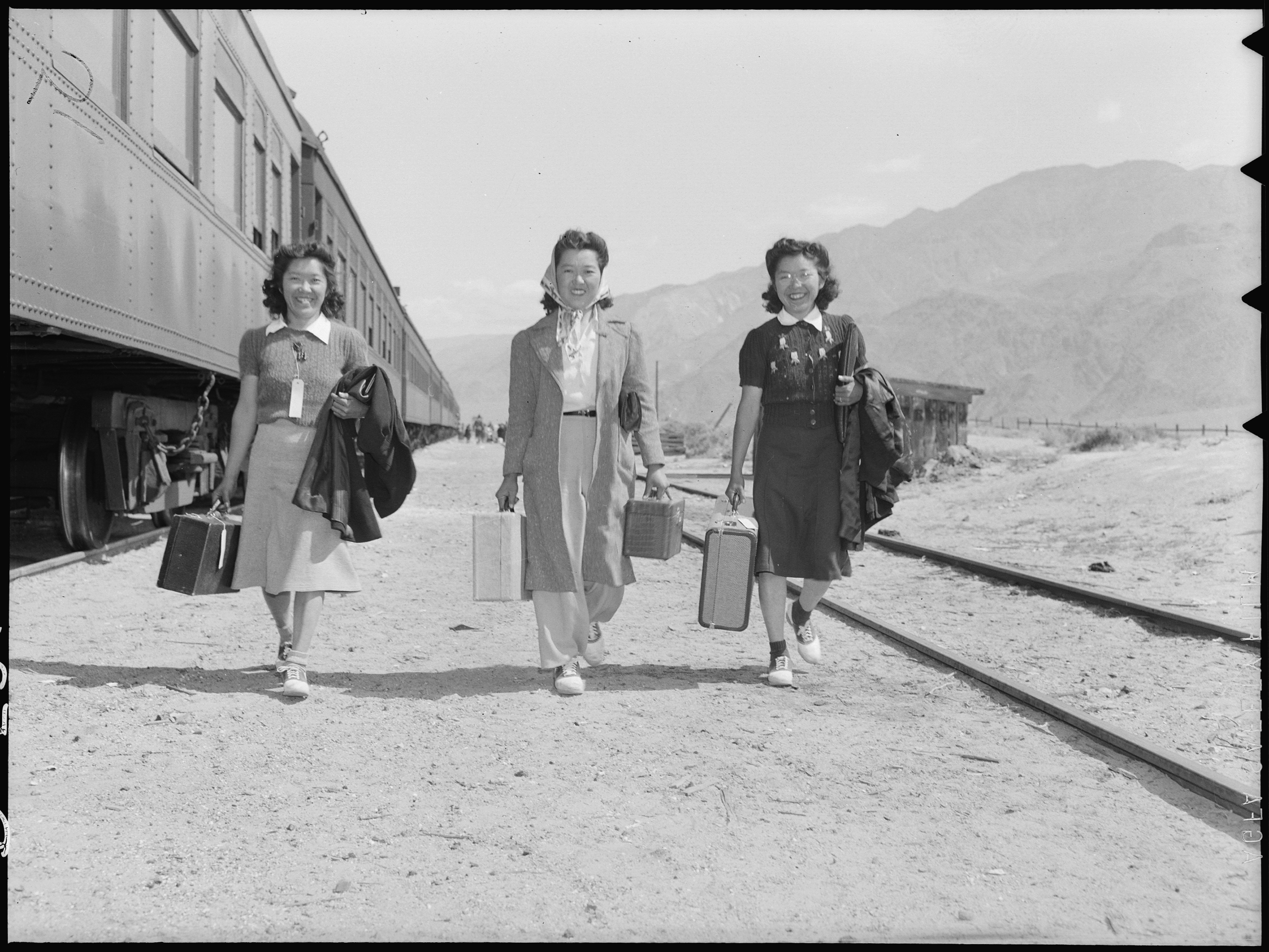 06/30/1946) Title Lone Pine, California. Arriving by train at Lone Pine from Elk Grove, California. Newcomers are tr . . . Scope and content: The