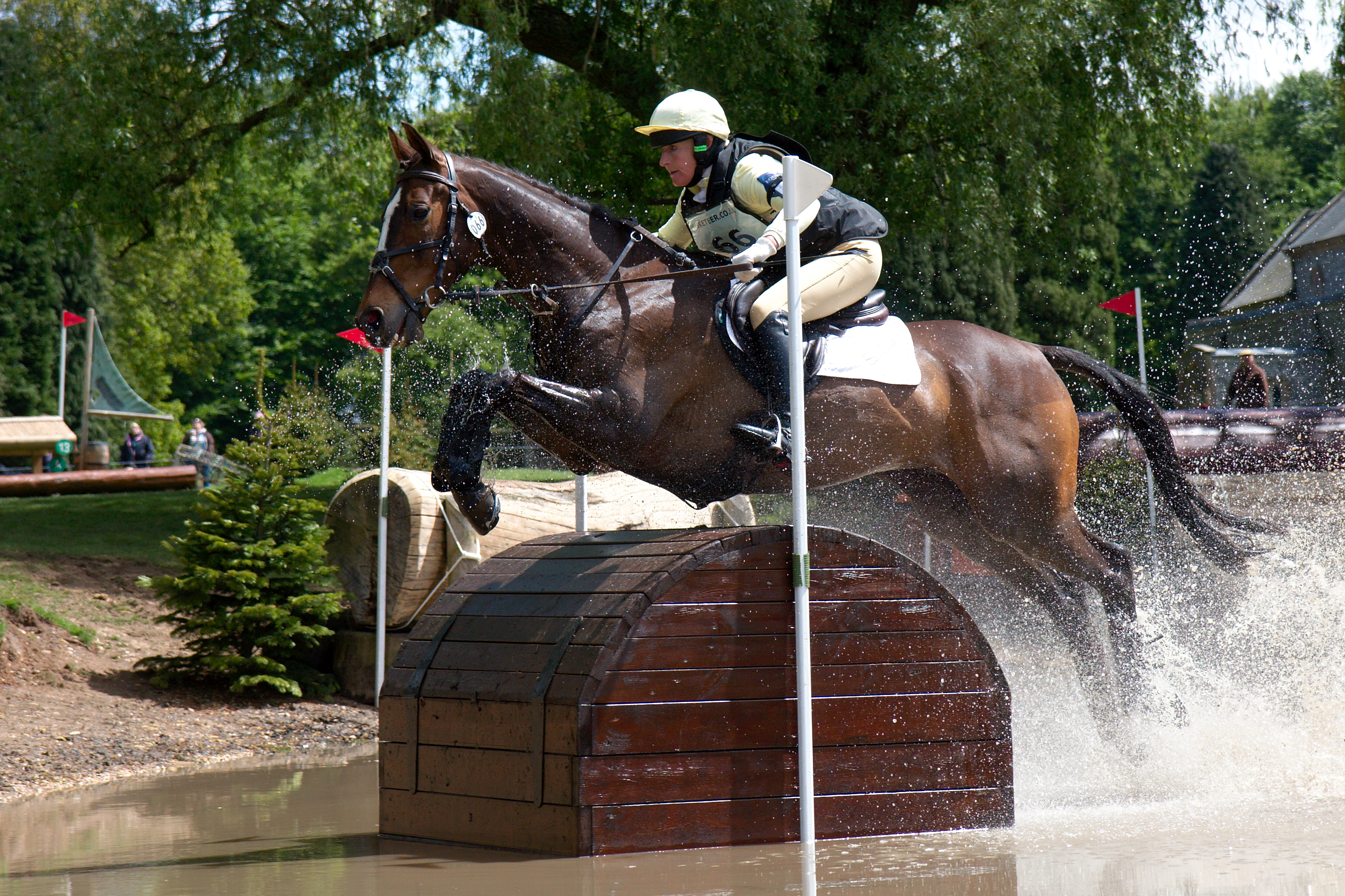 Lucinda Green and Cry Freedom at the Treasure Chests during the cross-country phase of the CIC*** competition at Houghton International Horse Trials 2013.