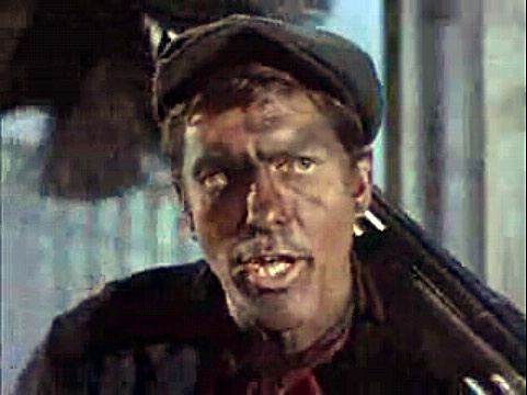 Dick van Dyke covered in soot playing a chimney sweep in Mary Poppins