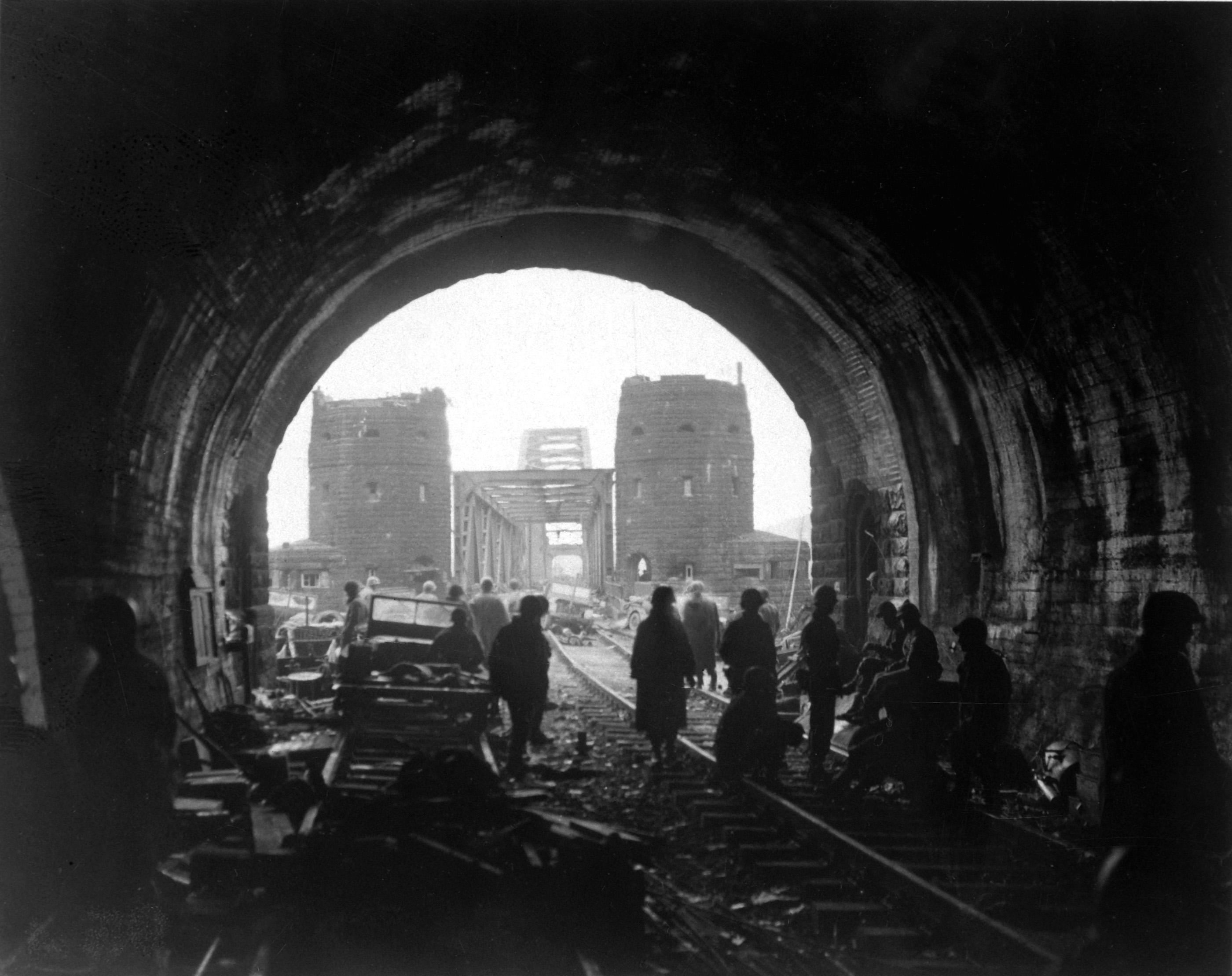 Men and equipment pour across the Bridge