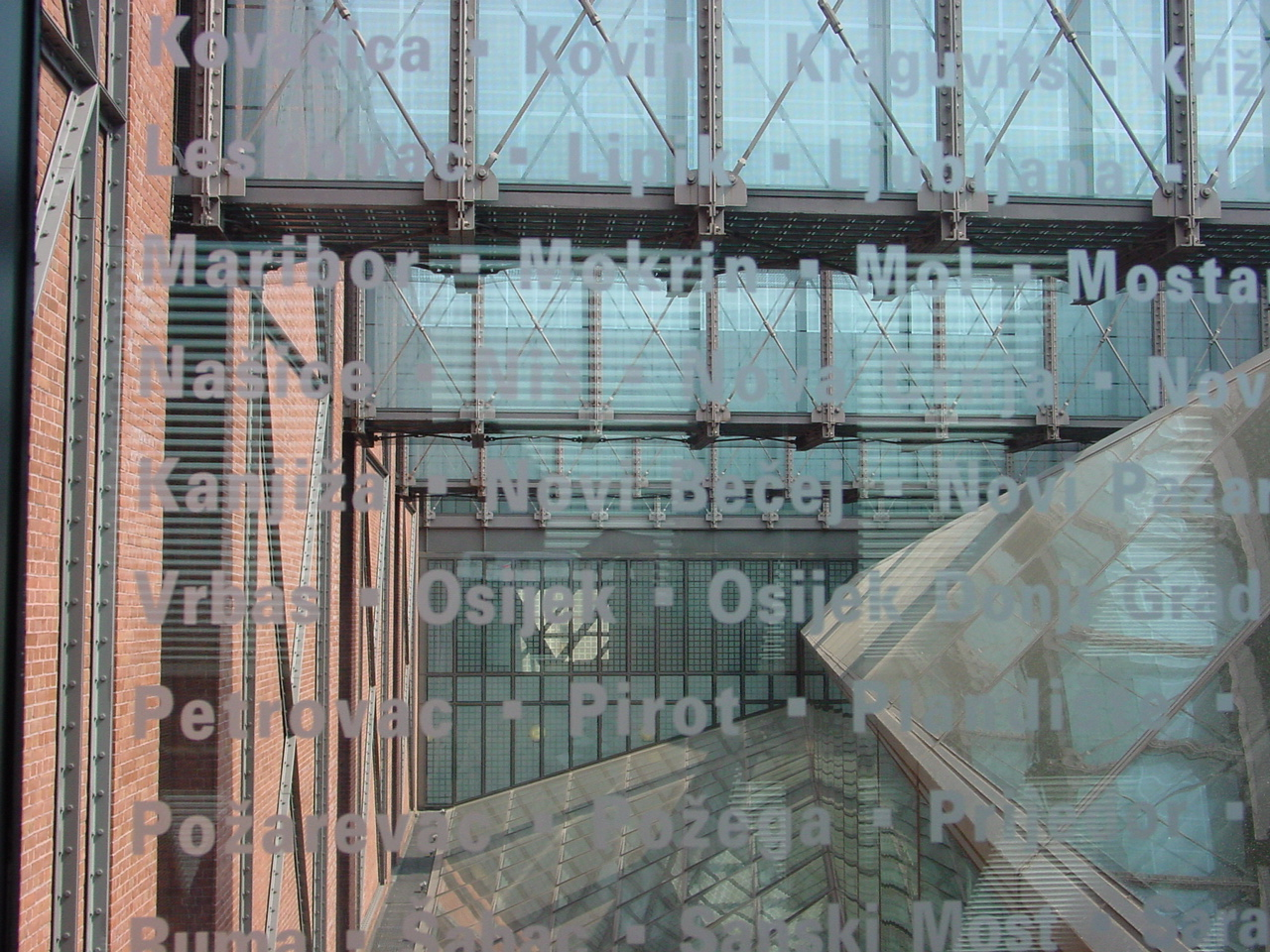 Glass bridges at the USHMM. Blue glass etched with names and places lost during the Holocaust.
