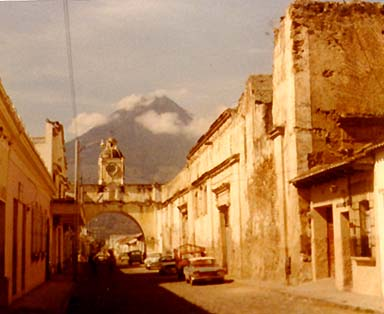 Arch connecting two parts of old Convent, Volcan de Agua in background Antigua2.JPG