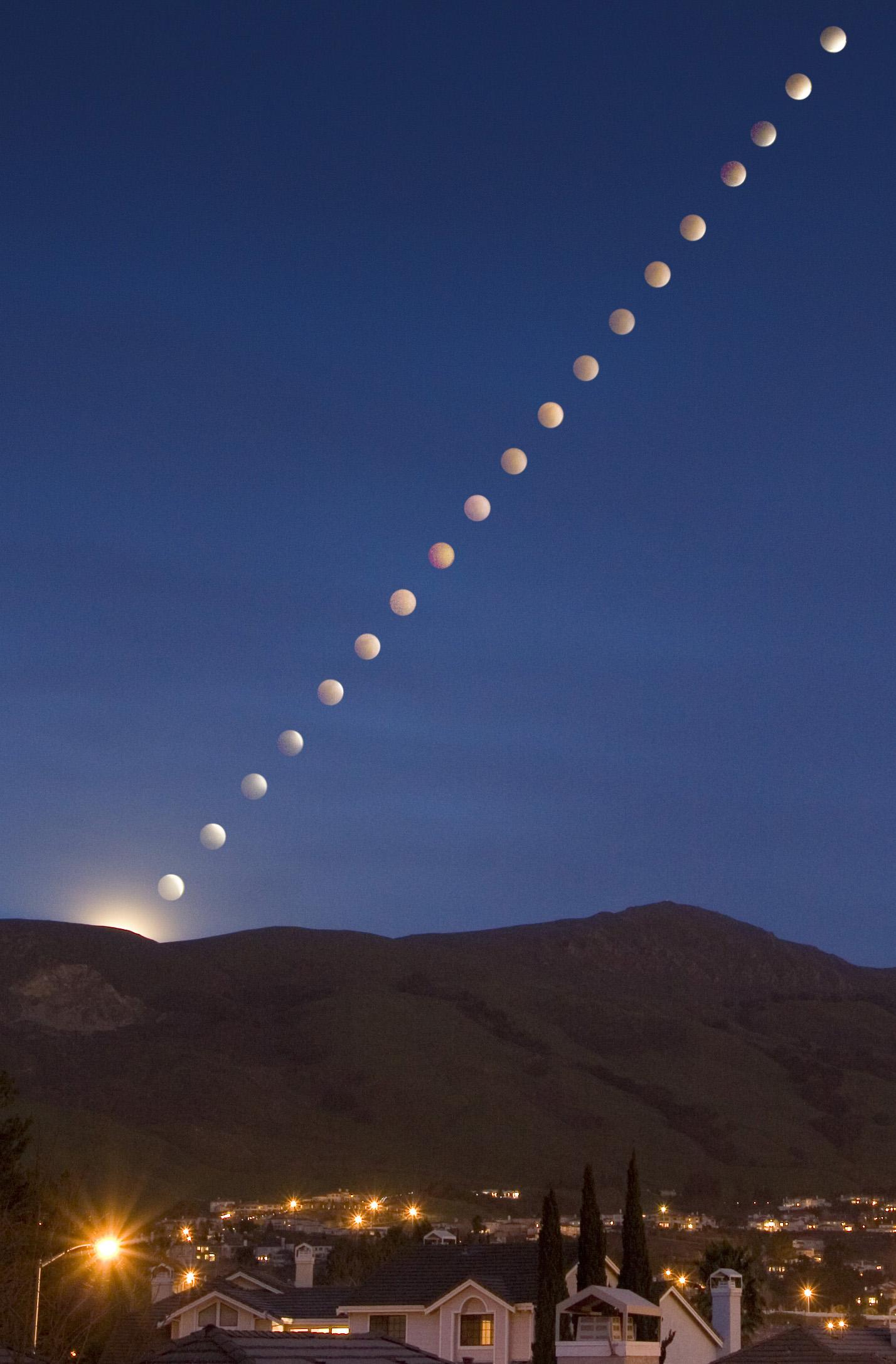 A rare lunar eclipse (shown in time lapse composite) rises over Mission Peak in Feb. 2008