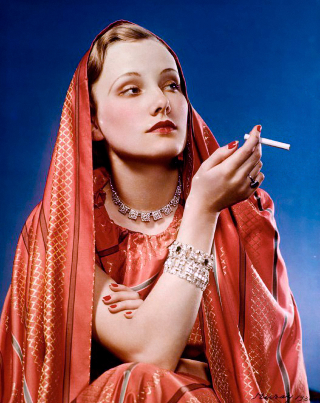 Girl in Red, 1936 photo for Lucky Strike Cigarette. Image via Wikipedia.