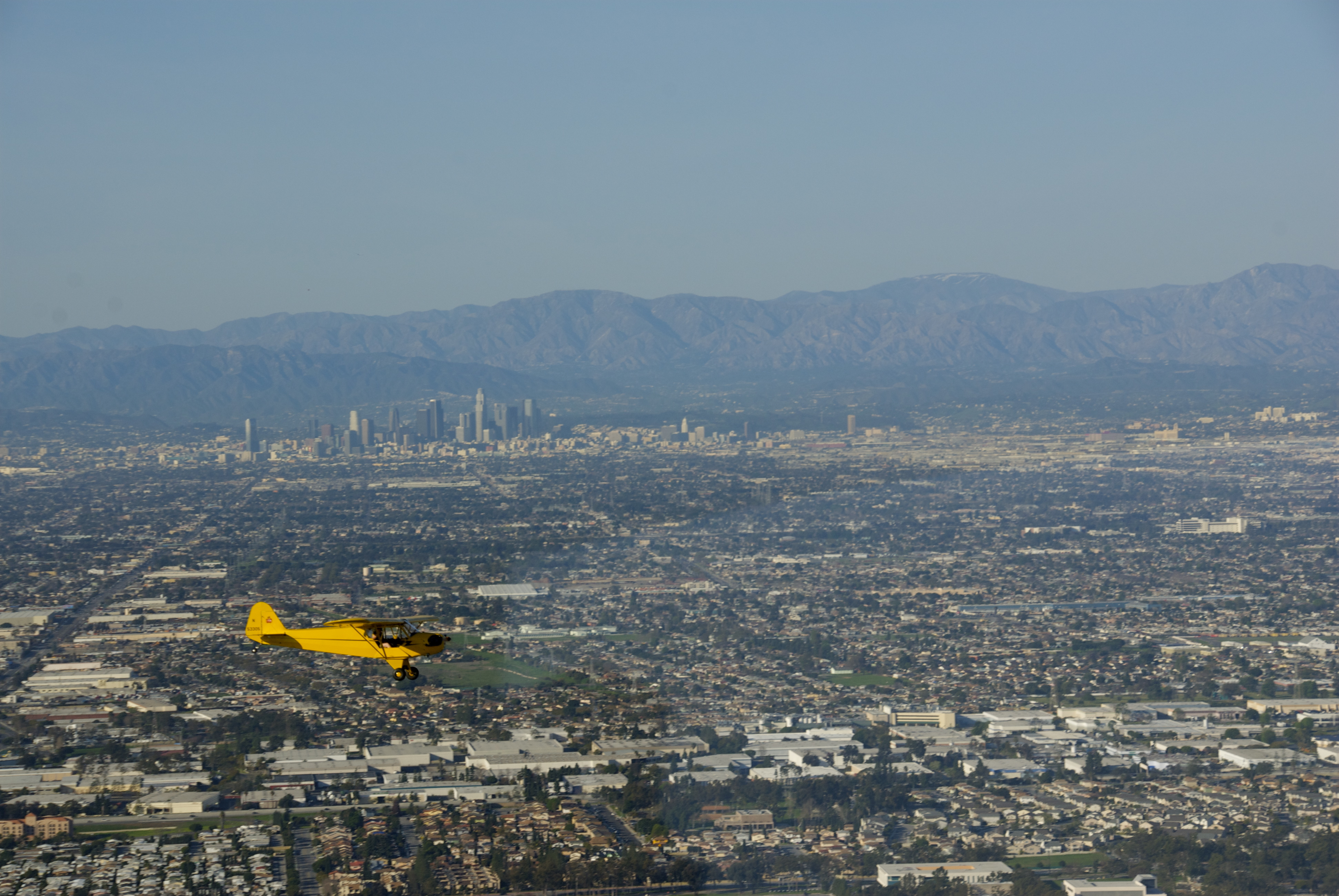 File:Piper Cub over Los Angeles from a hovering Eureka, hey