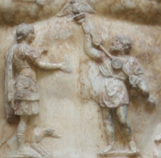 A close-up view of the breastplate on the statue of Augustus of Prima Porta, showing a Parthian man returning to Augustus the legionary standards lost by Marcus Licinius Crassus at Carrhae Augustus Prima Porta (detail).PNG